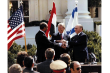 Anwar Sadat, Jimmy Carter and Menachem Begin shakes hands at the treaty signing at the White House on March 26, 1979.