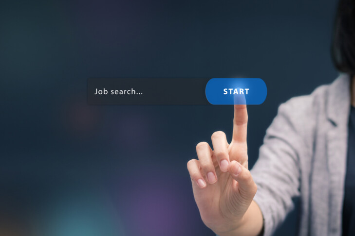 Woman searching job on the internet. Looking for job online and search button on virtual touch screen.